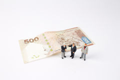 Mini business men on bank notes Royalty Free Stock Photography