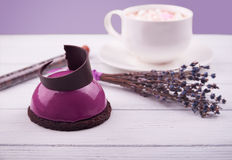Mini cake with black currant and creamy mousse. Mini cake with black currant, dark chocolate and creamy mousse with lavender and cup of coffee and marshmallow Royalty Free Stock Image