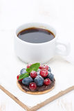 Mini cake with chocolate cream and berries and a cup of coffee Royalty Free Stock Photography