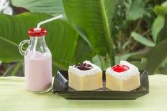 Mini cake  and Strawberry flavour milk Stock Photos