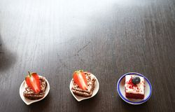 Mini cake on the table with copy space royalty free stock photo