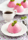 Mini cakes with black currant and creamy mousse. Stock Photos