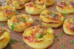 Mini cakes with corn and bell pepper. A bunch of mini cakes with corn and bell pepper Stock Photo