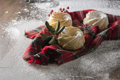 Mini Cakes holidays, on red checkered cloth Stock Photos