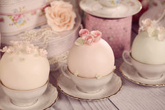 Mini cakes with icing. On a nice decor stock photography