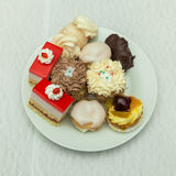 mini cakes on a white plate on the festive table setting Stock Images