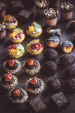 Mini cakes on wooden background Royalty Free Stock Images