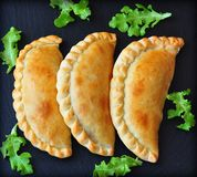 Mini calzone, closed pizza, Italian pastry stuffed with cheese and meat Royalty Free Stock Photography