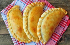 Mini calzone, closed pizza, Italian pastry stuffed with cheese and meat Stock Photography