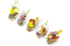 Mini canapes in plastic cups Stock Photo