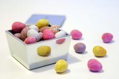 Mini candy chocolate eggs in a polished silver box.  Royalty Free Stock Photo