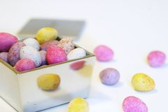 Mini candy chocolate eggs in a polished silver box.  Royalty Free Stock Photography