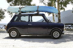 Mini car with kayak on top Stock Photos