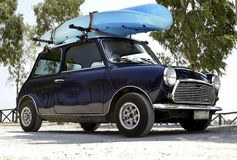 Mini car with kayak on top Royalty Free Stock Photos