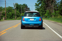 Mini car on the road royalty free stock image