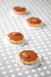 Mini Caramel Pies with Caramel Topping Stock Image