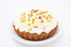 Mini carrot cake with mascarpone, honey, pistachios on a plate Stock Photos