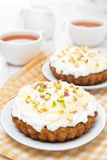 Mini carrot cakes with cream of mascarpone, honey on the plate Stock Image