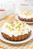 Mini carrot cakes with cream of mascarpone, honey and tea Stock Image