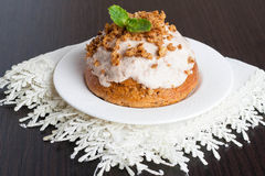 Mini carrot cakes with cream of mascarpone and honey on the whit. E table, horizontal stock photo