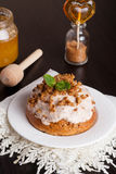 Mini carrot cakes with cream of mascarpone and honey on the whit. E table, vertical Royalty Free Stock Photography