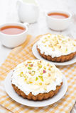 Mini carrot cakes with cream of mascarpone and honey Stock Image
