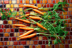 Mini Carrot vegetables on a tiles table Stock Images