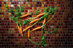 Mini Carrot vegetables on a tiles table Royalty Free Stock Images