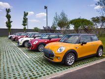 Mini cars for sale in showroom. Lined up Mini cars in dealership for sale Stock Photography