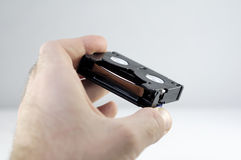 Mini Cassettes DV in een hand Royalty-vrije Stock Foto's