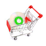 Mini CD in shopping cart isolated on white stock photo