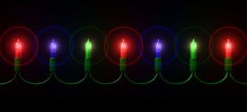 Mini chaîne de caractères de lumière de Noël Photos stock