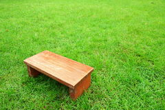 Mini chair on green  lawn Stock Images