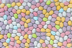 Mini chcocolate Easter eggs. Lots of candy covered multi coloured mini chocolate Easter eggs Stock Photos