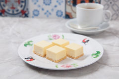 Mini Cheese Cakes. Slices of mini cheese cakes on a plate Royalty Free Stock Images