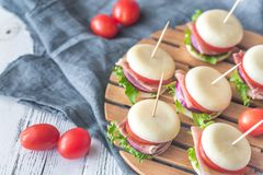 Mini cheese and prosciutto sandwiches Royalty Free Stock Photo