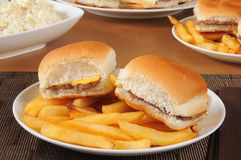 Mini cheeseburgers and fries Royalty Free Stock Images