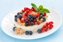Mini cheesecake with fresh berries on a blue background Royalty Free Stock Images