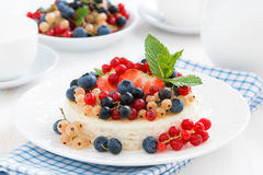 Mini cheesecake with fresh berries on a plate Stock Photos