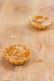 Mini cheesecake peach on a wooden table royalty free stock photography