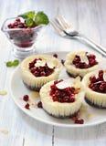 Mini cheesecakes with berries Stock Photo