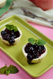 Mini cheesecakes with blueberry topping sauce Stock Photography