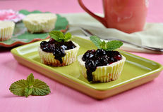 Mini cheesecakes with blueberry topping sauce Royalty Free Stock Image