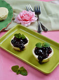 Mini cheesecakes with blueberry topping sauce Royalty Free Stock Photo