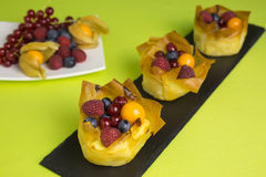 Mini cheesecakes with filo pastry and berries Stock Photo
