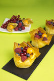 Mini cheesecakes with filo pastry and berries Stock Photos