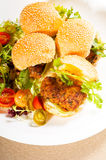 Mini chicken burgers Stock Images