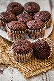 Mini Chocolate Brownie Cupcakes. On white wooden background royalty free stock photos