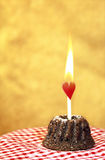 Mini cake with flaming heart Stock Photo