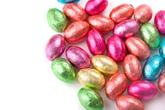 Mini Chocolate Easter Eggs on White background. A collection of multicolored mini foil-covered chocolate eggs Royalty Free Stock Photo